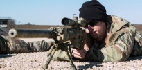 Soldier firing a M110 Semi-Automatic Sniper System