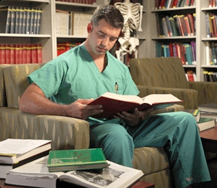 Medical student reading a textbook