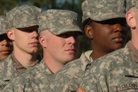 Soldier in hangar with helicopter