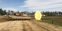 Soldiers firing the M1A1-SA Abrams Tank.