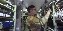 U.S. Army Soldier maintains intelligence and communications systems equipment