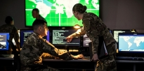 Soldiers in a Cyber room.