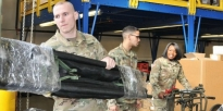 Soldiers assemble medical supplies for aid stations.