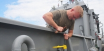 Watercraft operator standing on deck