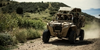 Special Forces Soldiers in a Leightweight Tactical All Terrain Vehicle (LTATV).