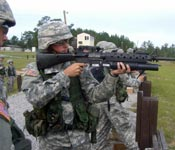 CDT Mack, an MSIII Cadet, aims his M203 grenade launcher at a range at Ft. Jackson, SC.