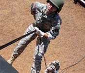 Cadet Kim rappels down a wall during the Fall Field Training Exercise.