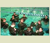 New Recruits learn a variety of skills such as how to make flotation devices from their uniforms.