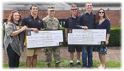 LTC Jajack presented U.S. Army ROTC Scholarships at cross-town schools.
