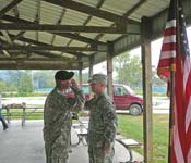 "Here, MSG Boxrucker is giving the ""first salute"" to newly commissioned 2LT Westen."