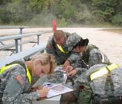 Some cadets preparing to go out on land navigation exercises during a FTX.