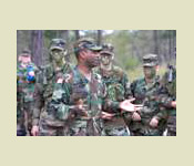 LTC Alfred Scott gives advice to the cadets during the Battalion FTX at Ft. Benning,, GA
