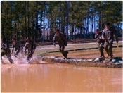 The GSU Ranger Challenge team competes in an annual competition against 42 other schools across the southeast. They trudge through the Malvesti obstacle course at ft Benning GA. Just one of the many events they complete throughout the competition.