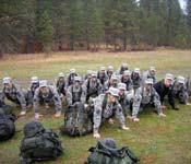 What's more fun than the push up? The cadets shown here are posing from the front leaning rest. They are all smiling because they have completed a weekend of training and are looking forward to a hot shower and clean clothes.