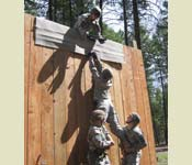 Infantry tactics are just one of the tools used to assess leadership potential. Every cadet will negotiate a Field Leader's Reaction Course (FLRC). This is another tool to help develop leaders. One cadet is put in charge of situation and has to use his team members and critical thinking skills to successfully negotiate the obstacle. Pictured here, are cadets working together to complete their course within the time standard.