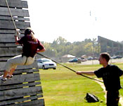 Cadets learn a variety of skill such as rappelling down a high wall.