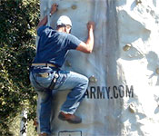 New cadets learn a variety of skills such as climbing the simulated rock wall.