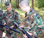 As a cadet, you learn and exercise real hands-on skills. Here, an experienced soldier shows a new cadet how to rapidly assemble and disassemble a weapon.