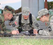 Cadet Gregg Z. goes over some last minute Land Navigation instructions with MS-II cadets at the battalion's fall FTX last semester.