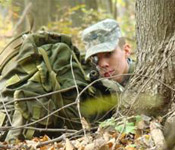 MS-I cadet Mark Dwyer secures his sector during the fall 2007 FTX. During these training weekends, MS-III cadets lead the underclassmen through various missions to get a feel of leading troops in the field.