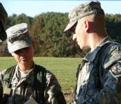Freshman Cadet Paige Campbell takes a moment to learn field craft from Battalion Executive Officer Charles Evans.
