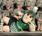 During the homecoming parade, our beloved mascot Sparty takes some time to pose with the cadets. Every year, Spartan Battalion takes part in the homecoming activities.