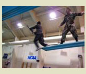Cadets are required to negotiate the Combat Water Survival Test (CWST) Here a cadet jumps off a 3 meter platform while blindfolded