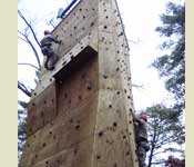 "Two Cadets are climbing the ""Rock Wall"" during their Fall FTX at Indiana State University's Field Campus."