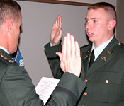 A cadet takes his oath in order to be commissioned into the United States Army.