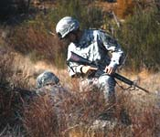 Cadets learn to execute a patrol in harsh terrain.