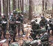 Cadet briefing squad on up coming reconnaissance mission during annual spring field training exercise.