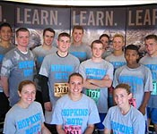 The JHU Army 10 Miler Team (11.4 miles, actually) raced to success this month! (standing: Jon Miller, Gavin Maguire, Justin Bristow, Joe Henderson, Alex Johnson, Mike Barnhart, Andrea Caruso, CPT Wallace, Robert Ferrell, Jeremy McCallum; kneeling: Jenna Parkinson, Alicia Knight, Kathy Cain.