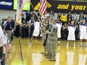 "The 42nd OVB Color Guard presents ""Old Glory"" at a Zips basketball game. The Akron ROTC Battalion plays a role in many University sports activities."