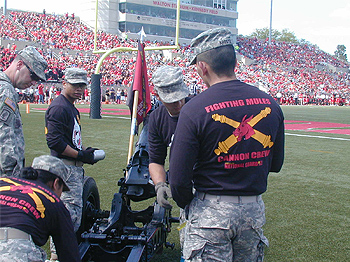 Cadets liven up the football games with the cannon crew.