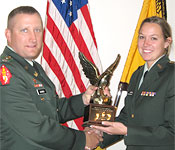 Cadet Jaclyn Adams receives the Iowa Army ROTC Outstanding Recruiter Award from LTC Todd Jacobus of the Iowa Army National Guard