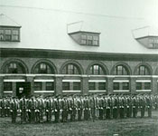 The Corps of Cadets forms up with the University Band in front of the old armory in 1907.
