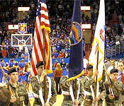 KU Army ROTC Cadets serve with honor as the present the Colors for the National Anthem prior to the start of a game at Allen Field House.