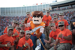 Pushing up the spirits of the miner football team, Paydirt Pete and UTEP cadets give necessary motivation to lead the team to a win!