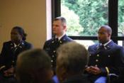 From Left to Right: Second Lieutenants Chambers, Coleman, and Mack prepare to be commissioned as Army Officers