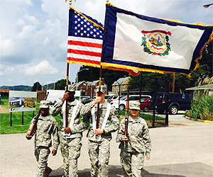 The Yellow Jacket Battalion Cadet Color guard marches off the field after presenting the colors at the annual Homecoming football game. During West Virginia State's Homecoming Weekend, Army ROTC also inducts new members into the West Virginia State University Army ROTC Hall of Fame.