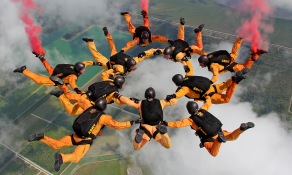 Golden Knights team members in formation during a jump