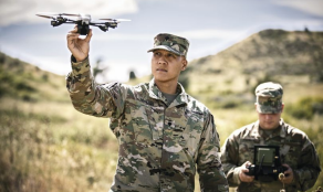 Soldier holding a Unmanned Aerial Vehicle Drone.