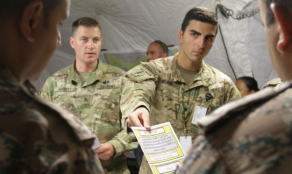 PSYOP Soldiers distribute information.