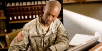 Army JAG lawyer writing briefing notes