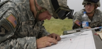 Soldier working on obtaining coordinates on map